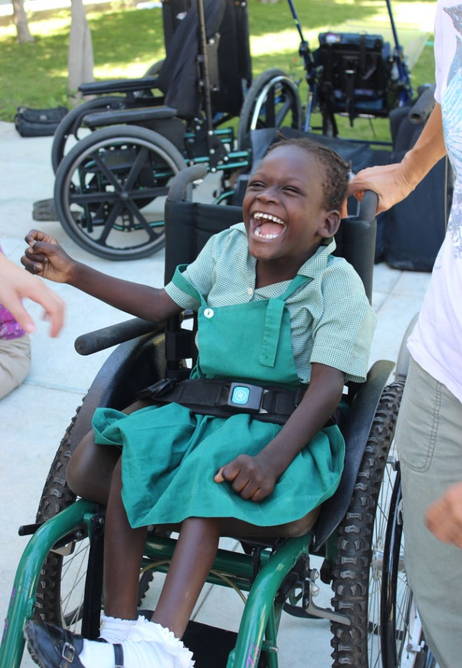 Roselan smiling in her new chair.