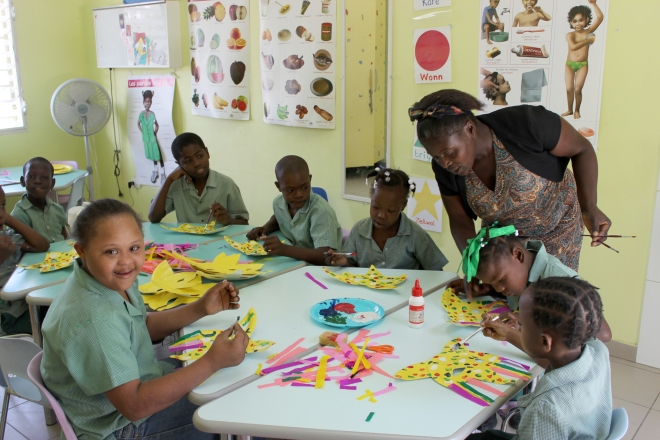 Professor Delicarme preparing Kanaval Masks with her class.
