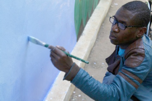 Christian helping with the Noah's Ark mural.
