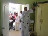 Fr. Rick blessing Kay Gabriel.